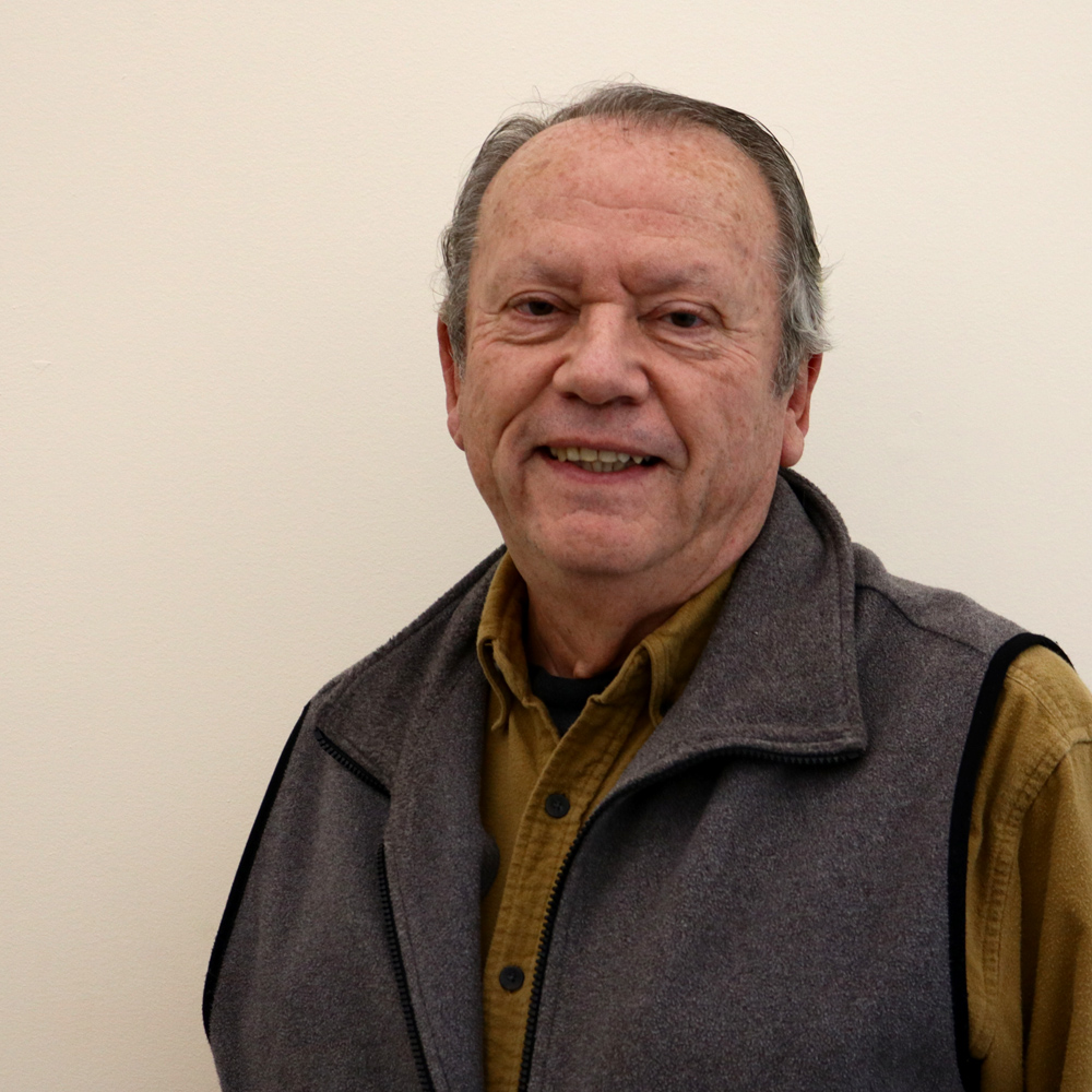 A headshot of Claudio Denoya